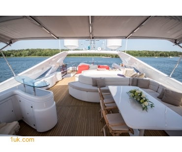 Dining table and seating area at the back of the boat