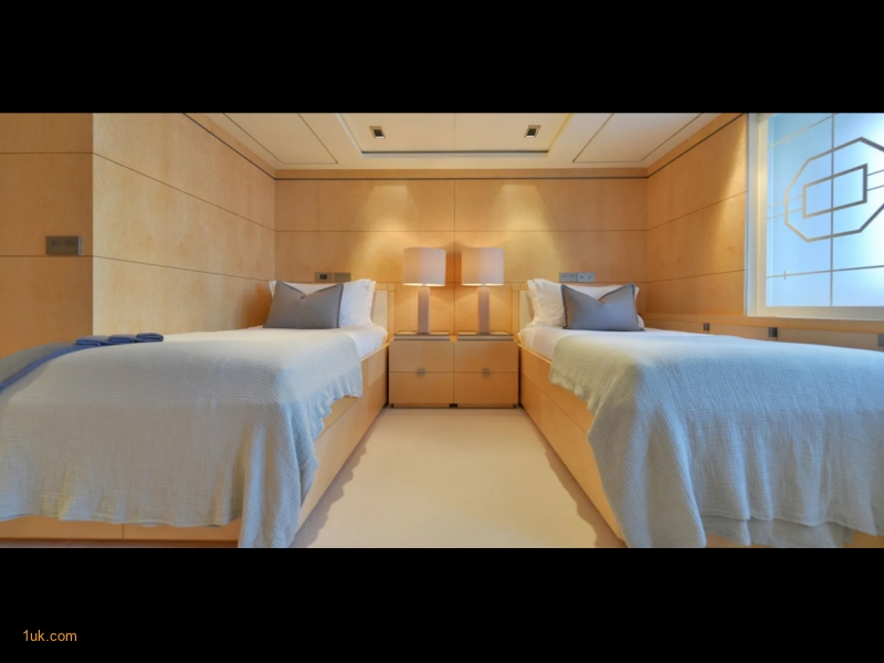 Twin bedroom for your younger guests on board Triple Seven