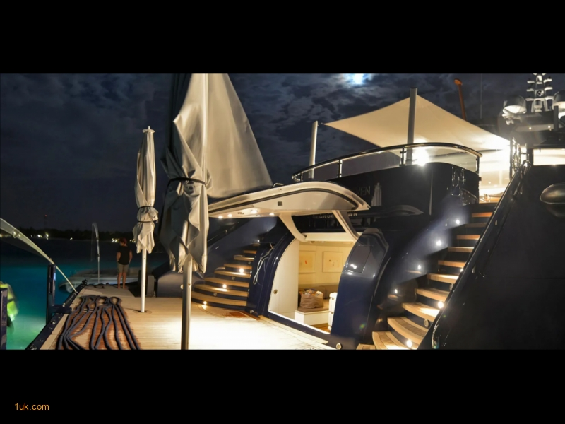 68m Triple Seven superyacht lit up in the evening