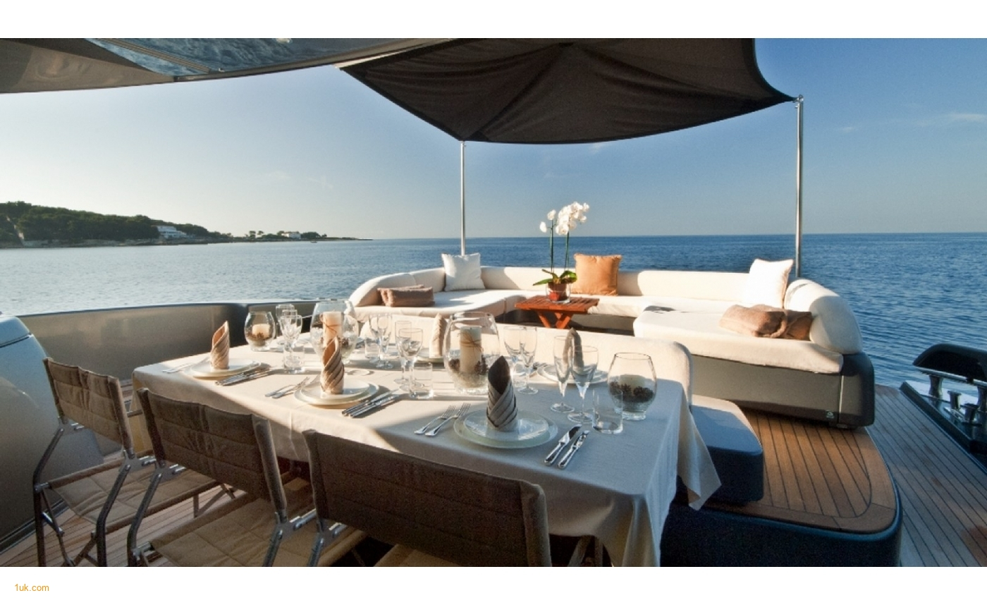 Stunning dining area on the sundeck of Riva Domino 86