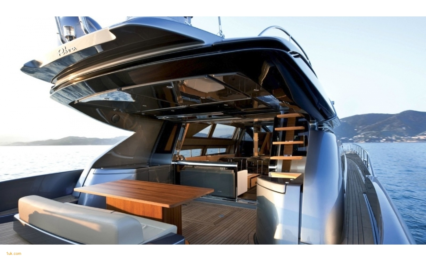 Large sundeck at the bow featuring a dinette and table
