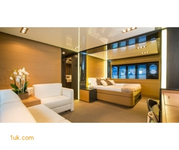 Large bed in the master cabin including a sofa