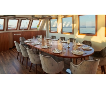 Luxury dining table and chairs for meals on board