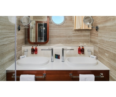 Twin sinks with toiletries and storage