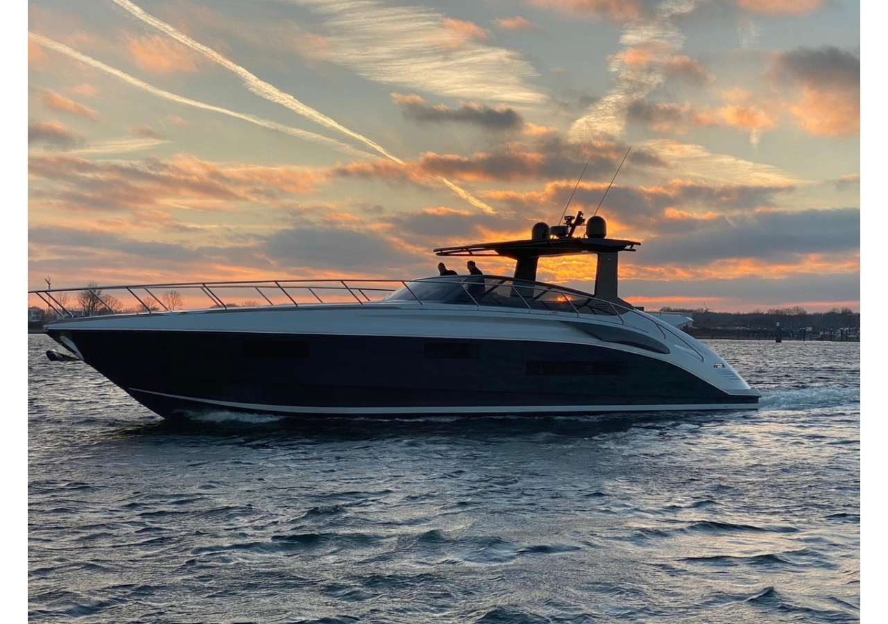 Side of the sports yacht in the sunset