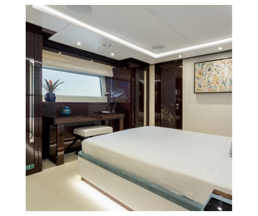 Dark wooden deck at the bottom of the bed