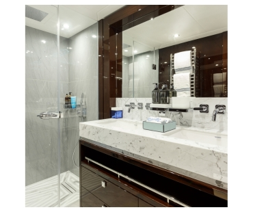 Dark wood and marble interior of the bathroom