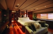 Double bed in the cabin of Ark Angel boat