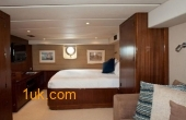 Master bedroom in the cabin on the 121 Narasaki Zosen Expedition Motor Yacht 1995