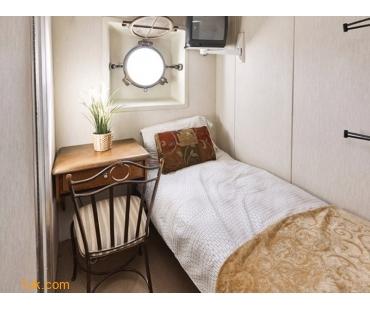 small bedroom on luxury yacht